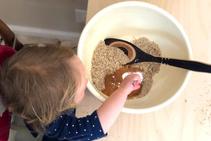 a toddlers stirring ingredients